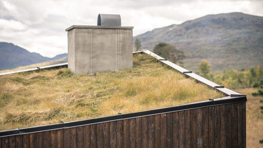 Planinska koliba sa zelenim krovom Norveškoj